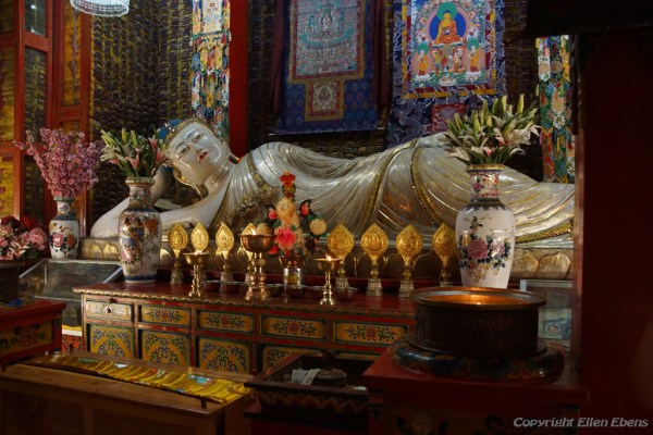 Reclining Buddha inside the big guilded stupa of Labang Monastery, Xiahe