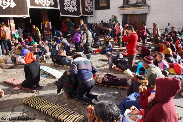 Lhasa, prostrating pilgrims in front of the Jokhang Temple