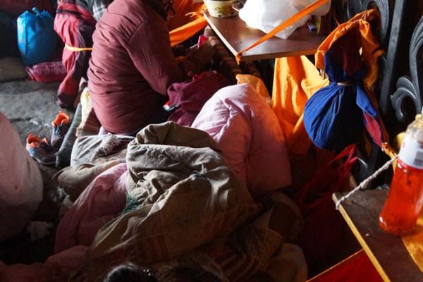 Lhasa, mandala praying at the entrance of the Jokhang Temple