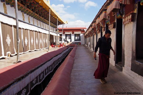 Lhasa, monk going to his room on the rooftop of the Jokhang Temple