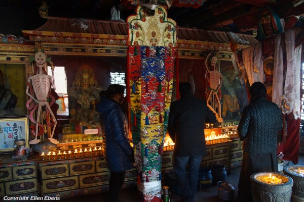 Pilgrims in a chapel on the second floor of the temple at Zhatang Monastery