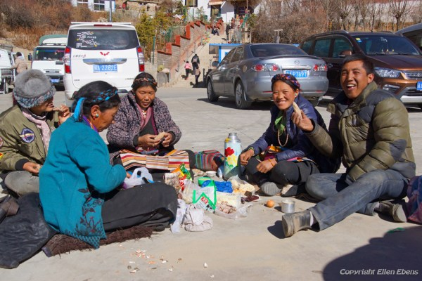 A Tibetan family having lunch at the parking area of Chimpuk Hermitage