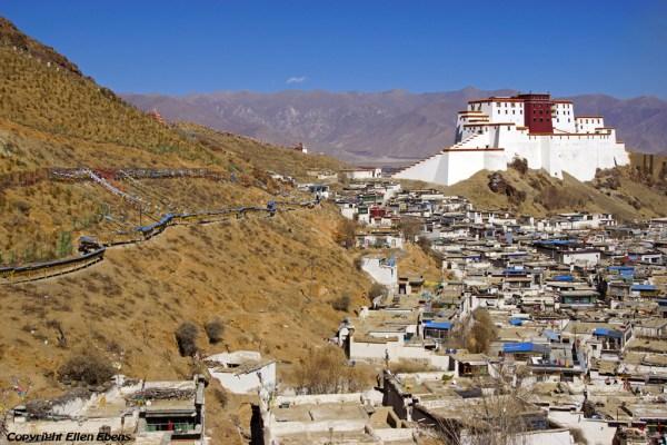 higatse: walking the kora around Tashilhunpo Monastery and looking down on the old Tibetan part of Shigatse and the Shigatse dzong