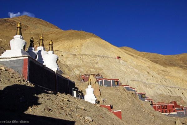 Walking the kora at Sakya and passing the stupas