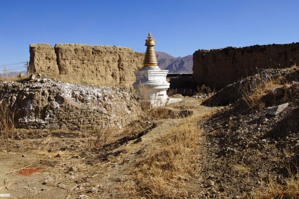 Old ruined stupa, new stupa and the old, ruined walls of Narthang Monastery