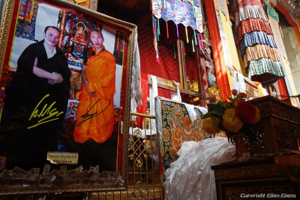 Inside Tsurphu Monastery with a picture of the 17th Karmapa, who is living in India now