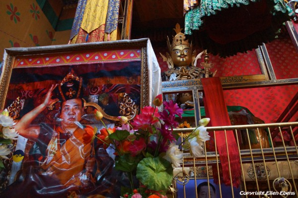 Inside Tsurphu Monastery with apicture of the 16th Karmapa