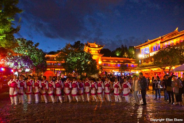 The ancient city of Lijiang. Naxi women dancing at the big square.
