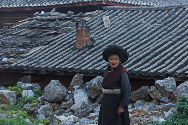 Lugu Lake. Woman in traditional clothing.