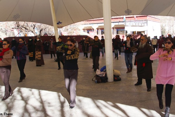 Lhasa, people dancing in the park behind the Potala Palace.