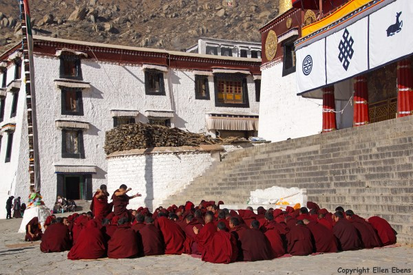 Lhasa, monks debating at the square before the main Assembly Hall of Drepung Monastery.