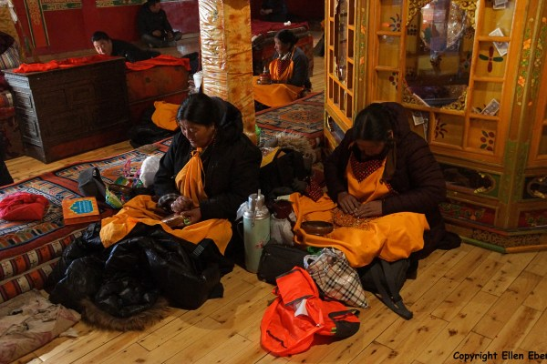 Ganden Monastery. Pilgrims are mandala praying in the chapel where the stupa of master Tsongkhapa is.