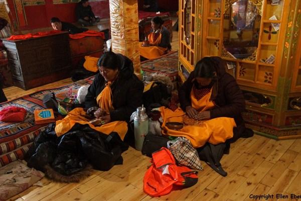 Ganden Monastery. Pilgrims are mandala praying in the chapel where the stupa of master Tsongkhapa is.