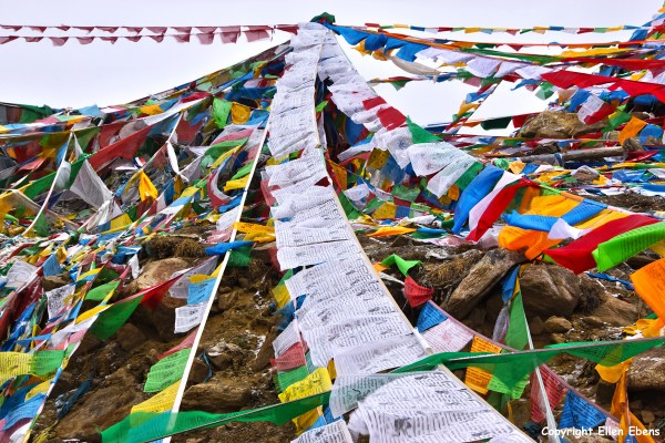 Prayer flags on the Serkyam La pass of Sejila Mountain pass (4,728 meters).