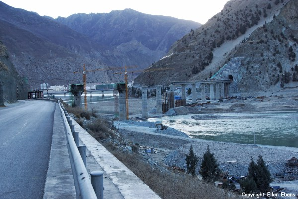 The Yarlung Tsangpo River valley with at the background the town of Nanxiang with the construction of the railway from Chengdu to Lhasa.