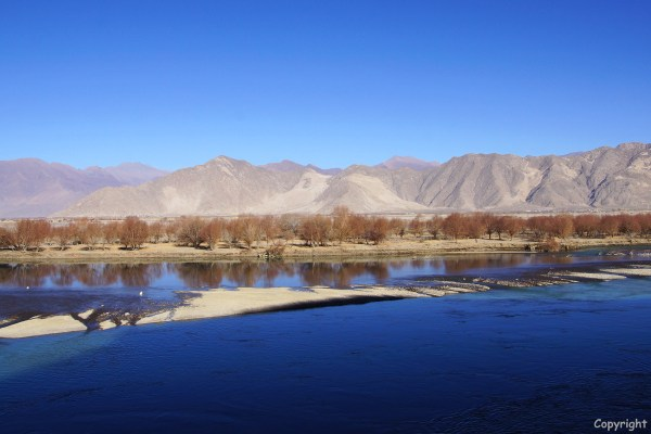 Driving through the Yarlung Tsangpo river valley in the direction of the Yamdrok Tso Lake