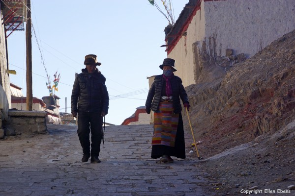 Elderly couple walking in a street in the town of Gyantse