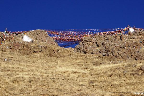 Prayer flags in the mountains above Tashilhunpo Monastery, Shigatse