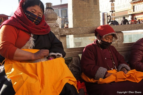 Lhasa, mandala praying pilgrims in front of the Jokhang Temple