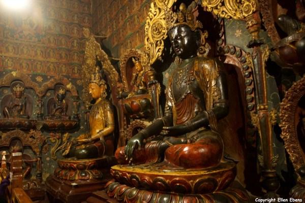 Wooden statues inside the Pelkor Chöde Monastery
