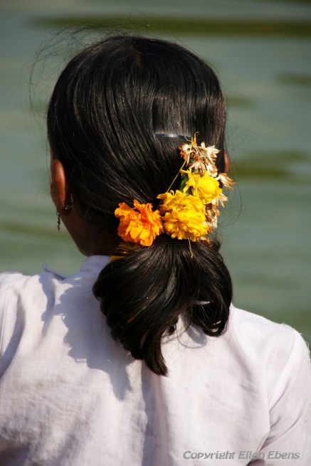 Girl with flowers in her hair in the village of Badami