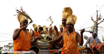 A religious procession with a precious statue in a small town in India