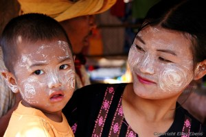 A mother and her young son at the five day market of Khaung Daing, Inle Lake