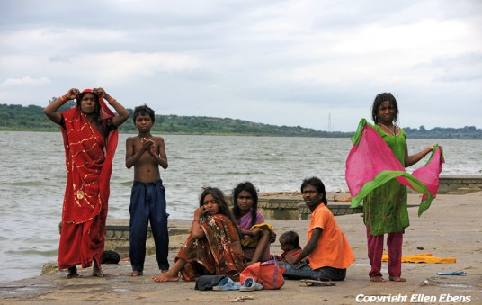 Family at the ghats at the river, Maneshwar