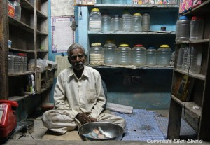 A man sitting in his little shop in the city of Maneshwar