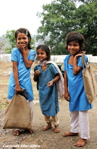 Three girls going to school in the city of Omkareswar