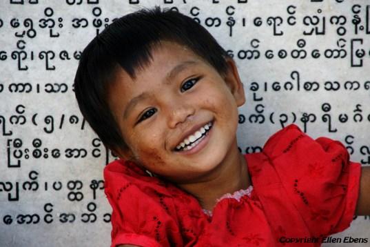 Young girl at the Kaunghmudaw Pagoda near Mandalay