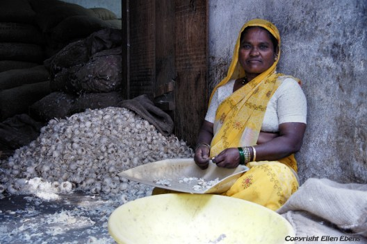 A woman peeling garlic in the city of Bijapur