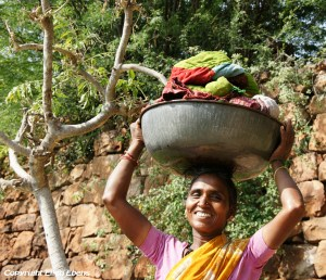 Women washing clothes at thWomen washing clothes at the ghats at the small town of Badamie ghats at the small town of Badami