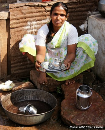 Woman washing the dishes in Badami