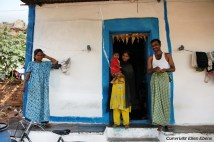 A family in front of their house in Badami