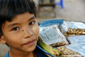 A boy selling nuts at the city of Pyay