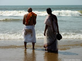 A older Indian couple at the beach of Gokarna