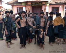Men at a procession in the town of Gokarna