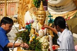 Yangon, offering at the Swedagon pagoda