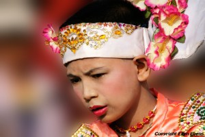 In a little village on the road from Bago to Toungoo: a dancer at the procession of schoolchildren because of the New Moon Festival