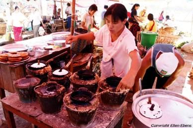 Cooking food at the market at Pindaya