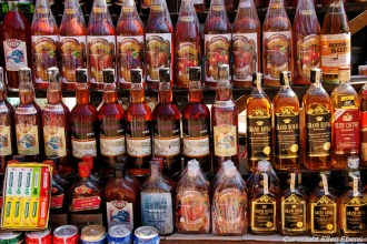 Maymyo, bottles of rum, wine or wisky for sale