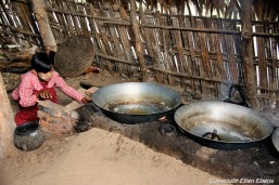 On the road from Bagan to Mount Popa, heating the coconut oil to make an alcoholic drink