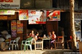 On the road from Bagan to Pyay, a family sitting in front of their shop