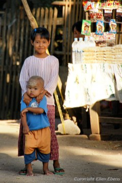 On the road from Bagan to Pyay, a girl with her little brother