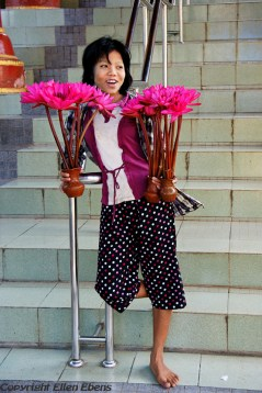 Near Pyay, a girl selling lotus flowers at the Shenattaung Pagoda
