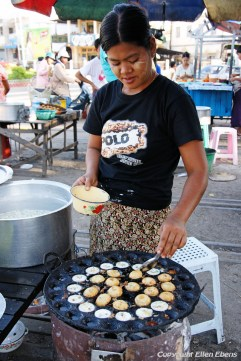 Pyay, preparing food - frying little eggs - at the market