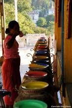 Pyay, woman drinking water at the Shwehsandaw Pagoda