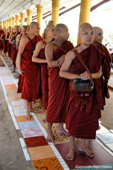 Bago, monks waiting in a row and ready to have lunch at the Kha Khat Wain Monaster