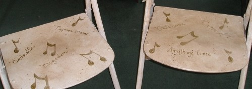 Old folding chairs updated with broadway musical titles- Musical Chairs by Ellen Leigh